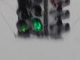 Grüne Ampel im Schnee / Zum Vergrößern auf das Bild klicken